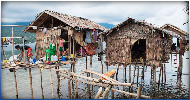 houses standing on long bamboo poles