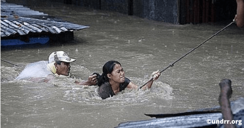 The man and the woman struggled to hold tight onto the rope to be rescued from the floodwater, Ondoy typhoon