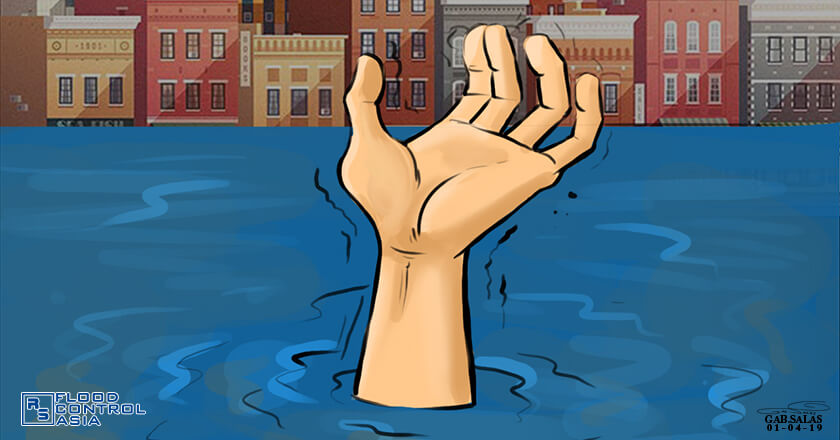 shows hands drowning in flood with buildings and homes in the background also submerged in flood.