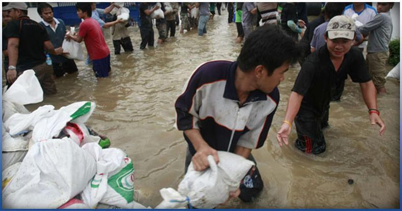 people putting sandbags againts flood