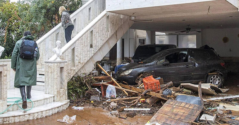Destroyed house and cars by flooding