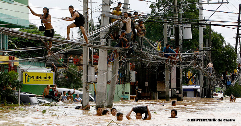 Bridge over troubled water: People walking on electricity cables to get to another place Bridge over troubled water: People walking on electricity cables to get to another place, Ondoy typhoon