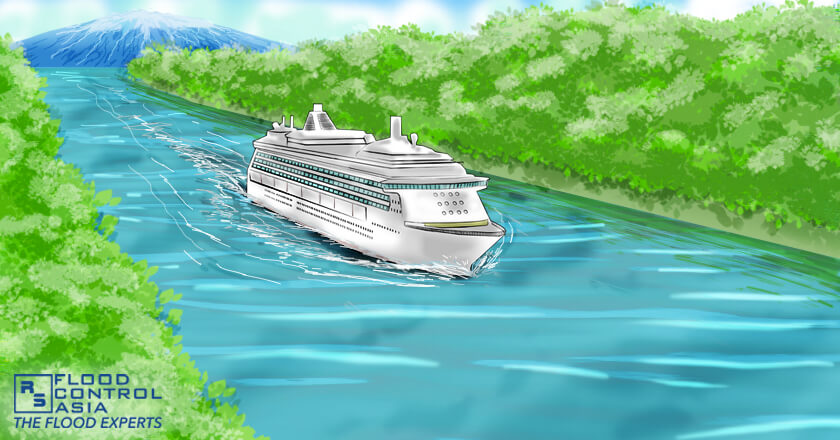 A waterway where a cruise is passing,  canal flood risk