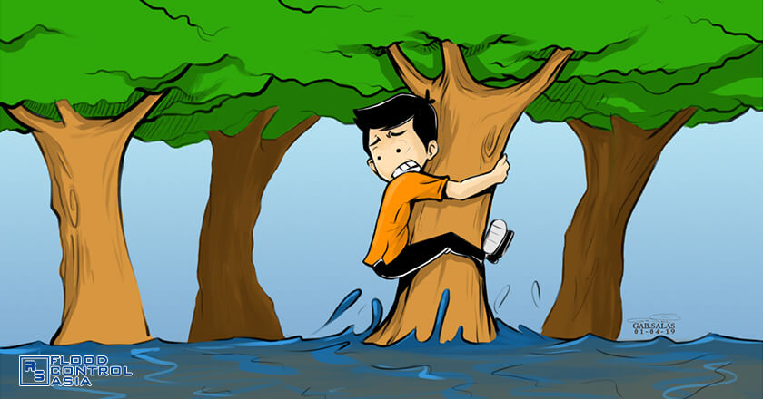 shows a person clinging to a tree to save himself from the flood.