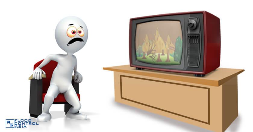 man watching fire news